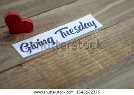 Giving Tuesday donate charity concept with text on wooden board #1548662375