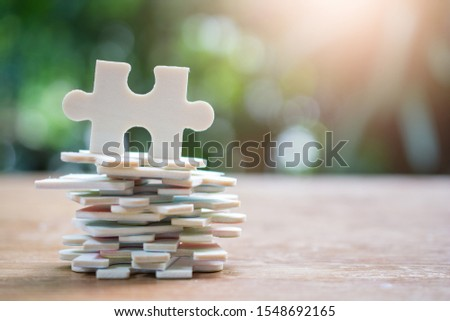 jigsaw puzzles set on wood floor for concept team work successful business #1548692165