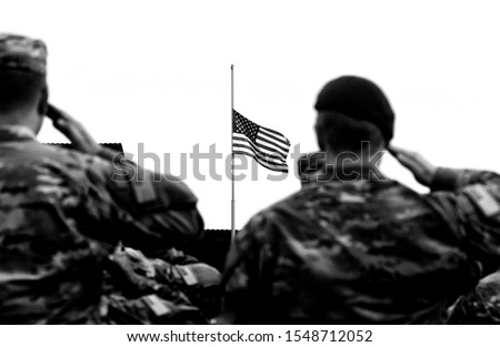 American soldiers saluting US flag. US Army. US troops. Military of USA. Veterans Day #1548712052