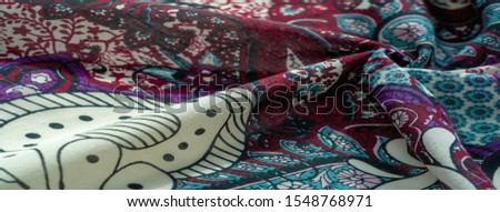 Background texture. cotton women scarf black and white pattern on one side of the scarf and color paisley pattern on the other side #1548768971
