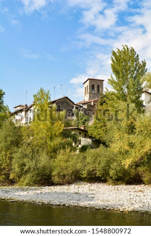 Small town in north-east Italy, on the banks of a river surrounded by nature #1548800972