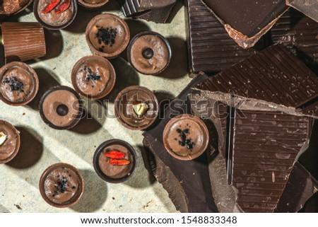Chocolates and chocolate bar. Hand made chocolates in small handcraft workshop. Chocolate bar. #1548833348
