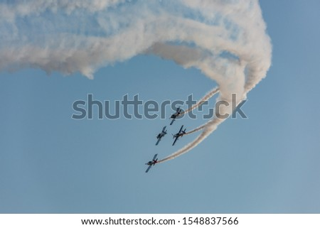 Airplanes on airshow. Aerobatic team performs flight at air show #1548837566