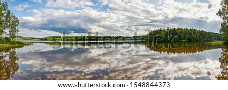 Panoramic view across the lake Gissen in Vimmerby at Smaland, Sweden #1548844373