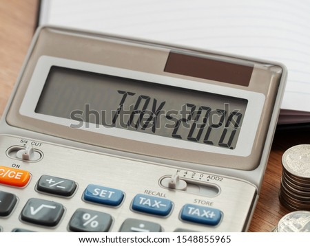 Tax word and 2020 number on calculator. Business and tax concept. Pay tax in 2020 years. #1548855965