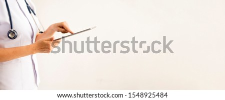 Close up on hands woman nurse with   stethoscope holding digital laptop on white background  ,Healthy  medicine healthcare  concept , banner for text #1548925484
