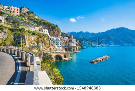 Road leading along Amalfi coast to small town Atrani in province of Salerno, Campania region, Italy. Amalfi coast is popular travel and holyday destination in Italy. #1548948383
