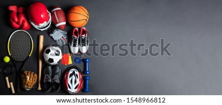 An Overhead View Of Different Sports Equipment On Gray Background #1548966812