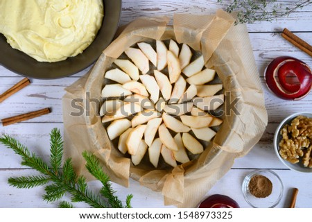 cooking apple pie do it yourself. photo from a series of pictures about cake preparation. tutorial. top view, flat lay. photo 9, apple slices are placed in a baking dish