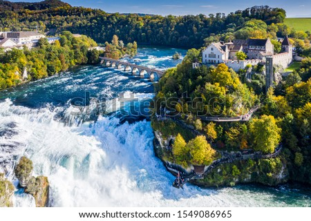 Rhine Falls or Rheinfall, Switzerland panoramic aerial view. Tourist boat in waterfall. Bridge and border between the cantons Schaffhausen and Zürich. Cliff-top Schloss Laufen castle, Laufen-Uhwiesen #1549086965