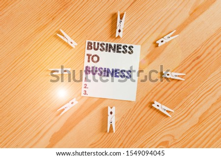 Word writing text Business To Business. Business concept for Commercial Transaction between two Businesses Colored clothespin papers empty reminder wooden floor background office. #1549094045