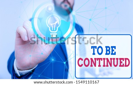 Writing note showing To Be Continued. Business photo showcasing indicate that the story continues in the next episode Male human wear formal suit presenting using smart device. #1549110167