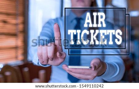 Conceptual hand writing showing Air Tickets. Business photo text individual is entitled to a seat on a flight on an aircraft Woman in the background pointing with finger in empty space. #1549110242