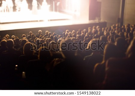 theater audience watching a show #1549138022