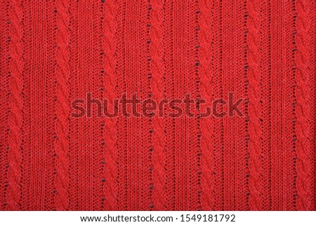 Knitted background. Knitted red texture. A knitting pattern of wool. Knitting. Background. #1549181792