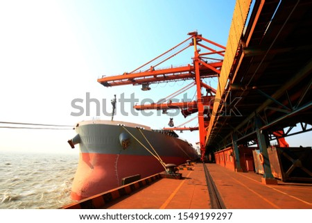 A freighter docked at the dock #1549199297