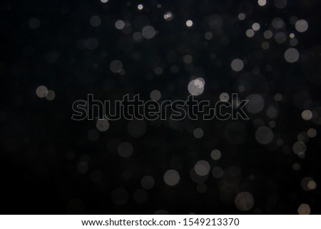 Fantasy bokeh sparkle from light on black background