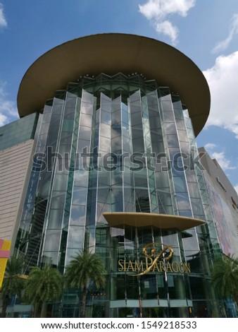 BANGKOK, THAILAND - NOVEMBER 3, 2019: Clouds reflect in upscale shopping mall Siam Paragon on November 3, 2019 in Thai capital Bangkok  #1549218533