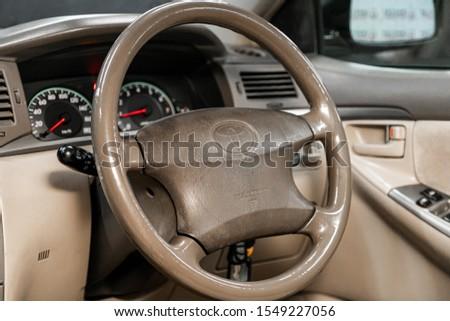 Novosibirsk, Russia – September 29, 2019:  Toyota Fielder, Black luxury car Interior - dashboard, player, steering wheel, speedometer #1549227056