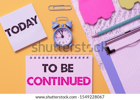 Word writing text To Be Continued. Business concept for indicate that the story continues in the next episode Notepad clipboard clip sheet marker car sticks alarm clock wood background. #1549228067