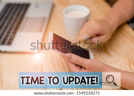 Conceptual hand writing showing Time To Update. Business photo showcasing act updating something someone or updated version program woman with laptop smartphone and office supplies technology.