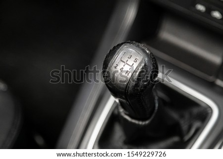 Novosibirsk, Russia – September 29, 2019:  Chevrolet Captiva, Close up of the manual gearbox transmission handle. Accelerator handle  in a new car. 