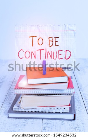 Conceptual hand writing showing To Be Continued. Business photo text indicate that the story continues in the next episode pile stacked books notebook pin color reminder white wooden. #1549234532