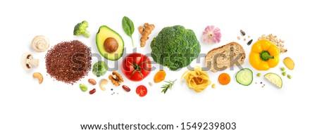 Creative layout made of walnuts, cashew, avocado, tomato, broccoli, bread, pasta, pepper, curcuma, rice and garlic on white background. Flat lay. Food concept. Macro concept. #1549239803