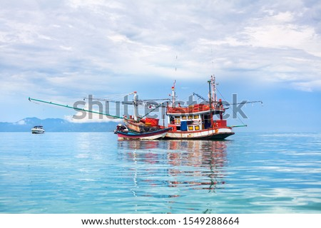 Fisherman boat on blue sea, sky, clouds landscape background close up, beautiful seascape with red wooden fishing vessel on turquoise water, traditional asian orange fishing trawler ship in Thailand #1549288664
