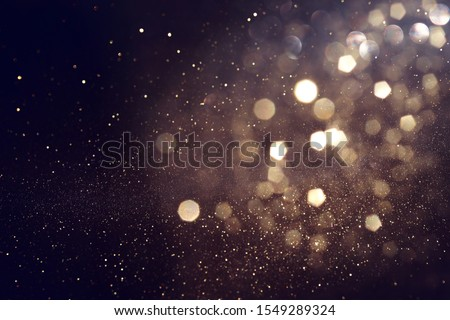 background of abstract glitter lights. gold and black. de focused #1549289324