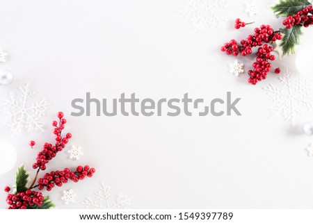 Christmas background concept. Top view of Christmas ball with snowflakes and red berries on white background. #1549397789