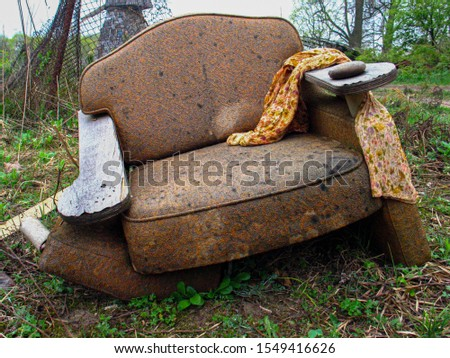 Old broken armchair in the forest. #1549416626