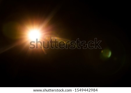 Abstract Natural Sun flare on the black #1549442984