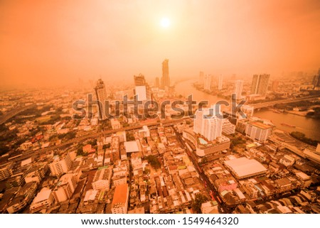 Top view of the city with many buildings and a river flowing through it. Bangkok, Thailand - January 15, 2018 #1549464320