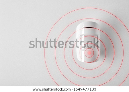 Modern motion sensor in action indoors Royalty-Free Stock Photo #1549477133