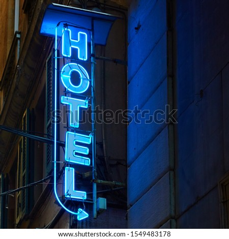 Neon hotel sign on the wall in the night