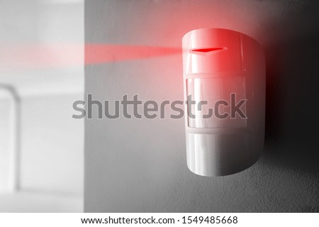 Modern motion sensor in action indoors Royalty-Free Stock Photo #1549485668