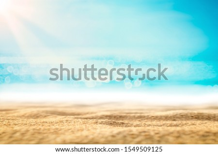 Copy space blur tropical beach with bokeh sun light wave on blue sky and white cloud abstract background. Summer vacation outdoor and travel holiday adventure concept. Vintage tone filter effect color #1549509125