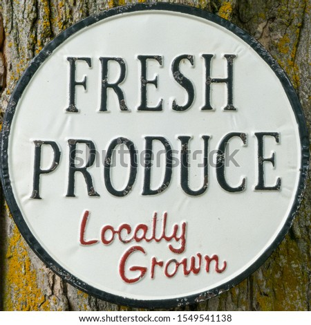 Fresh produce sign.  Rusted sign for farm stand.  Organic.  local grown