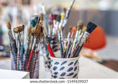 Several paintbrushes in a jar #1549639037
