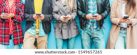 Group of friends using smart mobile phones app - Teenagers addiction to new technology trends - Concept of youth, tech, social and friendship - Focus on center hands  #1549657265