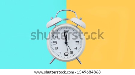 old alarm clock with 2 different background colors #1549684868