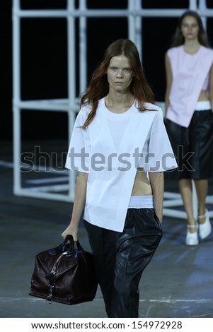 NEW YORK, NY - SEPTEMBER 07: A model walks the runway at the Alexander Wang Spring 2014 fashion show during Mercedes-Benz Fashion Week at Pier 94 in New York City on September 7, 2013 . #154972928