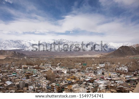 View landscape and cityscape of Leh Ladakh Village with Himalaya mountain range from viewpoint of Leh Stok Palace while winter season in Jammu and Kashmir, India #1549754741