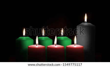 Kwanzaa holiday background with candle light of seven candle sticks in black, green, red symbolising 7 principles of African Heritage (Nguzo Saba) for African-American cultural celebration