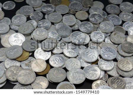 Close up of coins to stack of coins, Business Growth concept, There is money coins to stack of coins. Financial risk. #1549779410