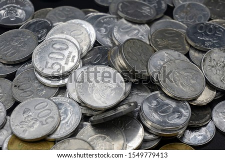 Close up of coins to stack of coins, Business Growth concept, There is money coins to stack of coins. Financial risk. #1549779413