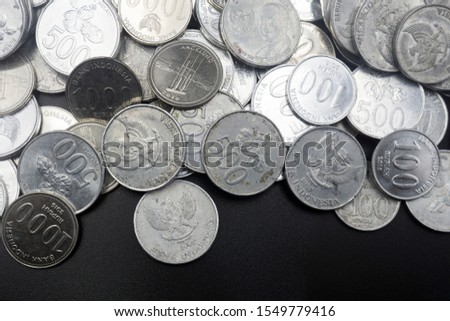 Close up of coins to stack of coins, Business Growth concept, There is money coins to stack of coins. Financial risk. #1549779416
