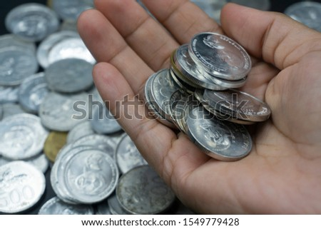 Close up of coins to stack of coins, Business Growth concept, There is money coins to stack of coins. Financial risk. #1549779428