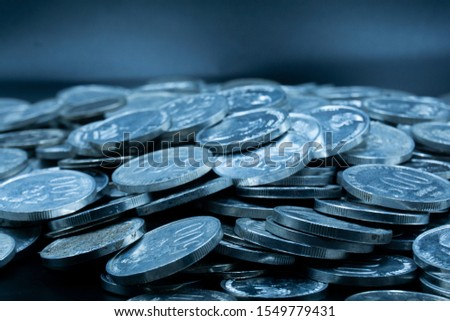 Close up of coins to stack of coins, Business Growth concept, There is money coins to stack of coins. Financial risk. #1549779431